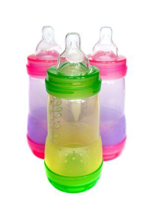nursing bottle: BPA-free multicolor  bottles for  formula Stock Photo