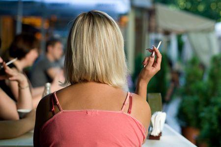 Blond girl enjoying life in urban cafe in Kiev, Ukraine