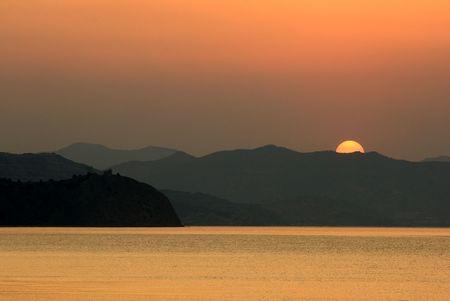 Sun rising above Crimean mountains, Black Sea, Ukraine Stock Photo - 3519247
