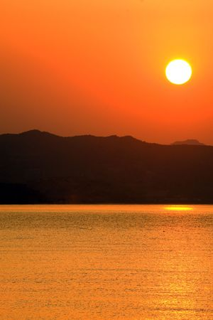 Sun rising above Crimean mountains, Black Sea, Ukraine Stock Photo - 3526477