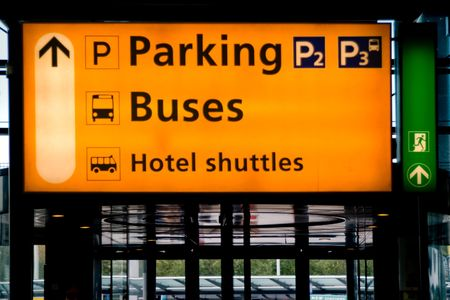 Parking and transportation signs in Schiphol airport, Amsterdam photo
