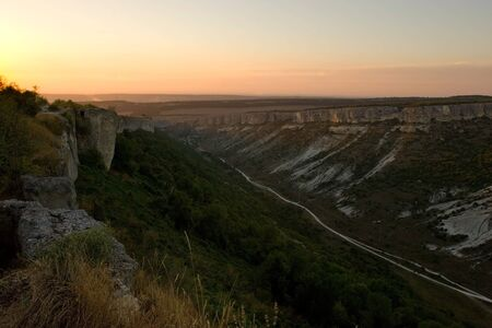 Sunset over Crimean mountains near Bakhchisaray, Ukraine photo