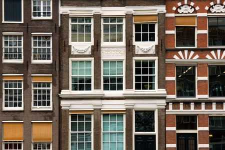 rowhouses: Facades of merchant houses along the canal, Amsterdam
