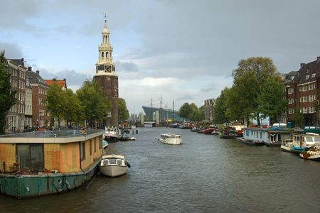 merchant: Houseboats and merchant houses along the typical Amsterdam canal Stock Photo