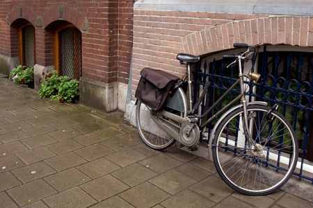 Traditional bicycle at Amsterdam street, Netherlands photo