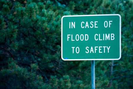 rescue west: Flood warning sign on local road in Colorado mountains Stock Photo