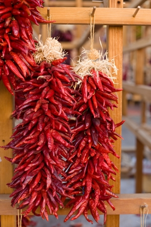 Chili peppers hanging on Santa Fe marketplace, New Mexico