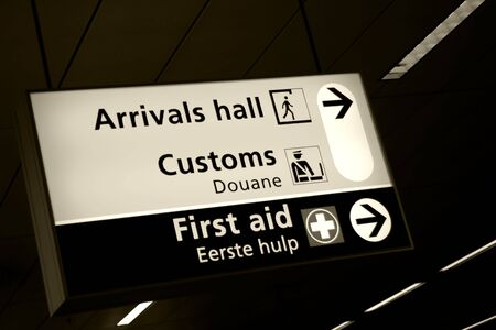 Directional sign in arrivals hall of Amsterdam airport photo