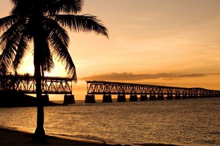 florida beach: Ruins of old railroad bridge in sunset, Florida Keys