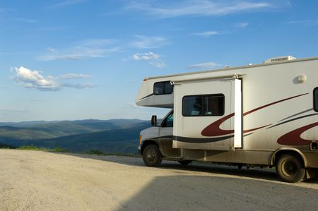 dirt road recreation: RV vehicle on Alaska dirty road Stock Photo