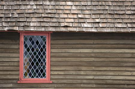 cape cod home: Colorful window in old house in Salem, MA