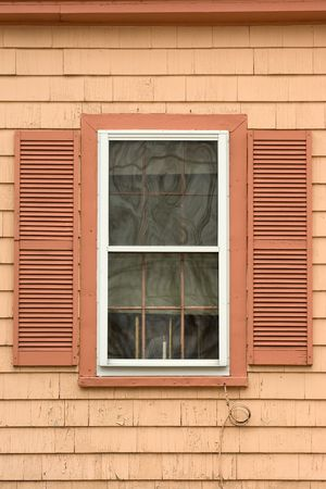 cape cod style: Colorful window in old house in Salem, MA