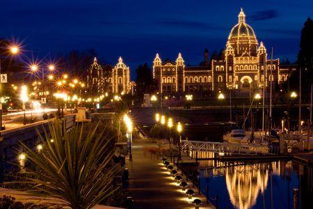 victoria bc: Illuminated parliament building and Victoria harbor at night