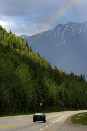 Car traveling on Trans-Canada hghway through Rocky mountains photo