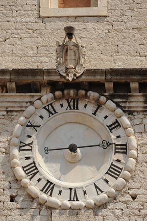 Clockface of St. Ivan church of old Croatian town of Sibenik Stock Photo - 5193283