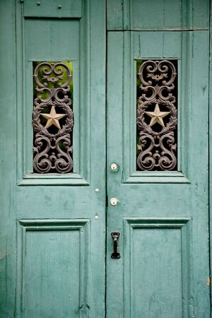 Green old wooden door in French Quarter, New Orleans