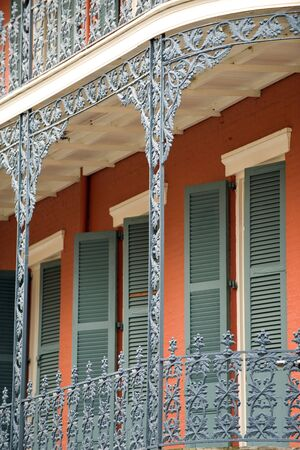Ornate ironwork gallery in French Quarter house photo