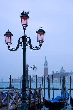 Street lamp and gondolas with view of San Giorgio Maggiore photo