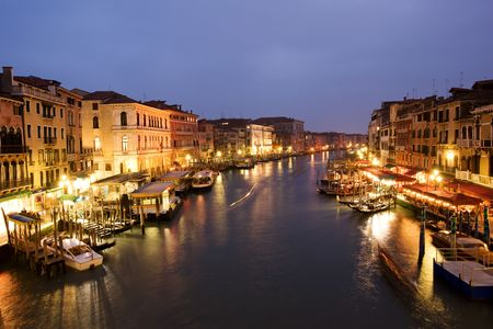 rialto bridge: Night life along Venetian Grand Canal by Rialto bridge Stock Photo