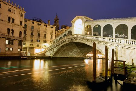 venice: Night traffic on Grand Canal under Rialto bridge, Venice
