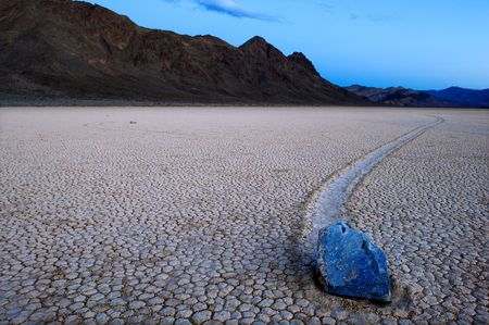 Moving stone in the desert of Death Valley national park, California, USA photo