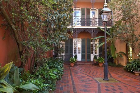 ironwork: Cozy front yard of French Quarter house, New Orleans Stock Photo