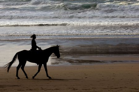 vacationer: Girl riding a horse at Cannon beach, Oregon coast, USA Stock Photo