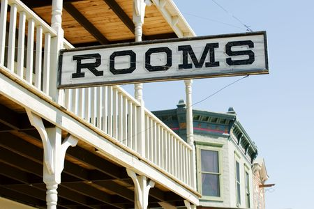 for rent: Sign for available rooms in the old western hotel