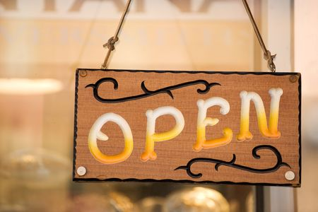 Open sign on the door of country western shop Stock Photo - 6369018
