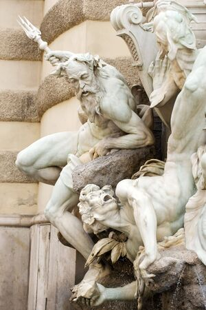 Close up of Neptune fountain on Hofburg palace facade