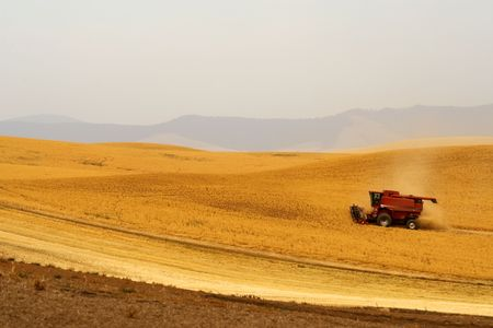 Combine harvester in the Palouse Hills crop fields, Washington state