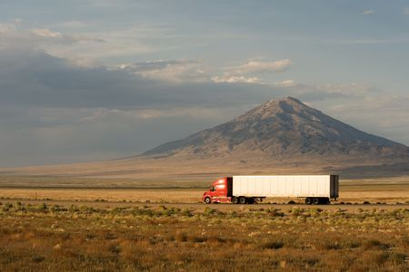 Delivery truck moving on Interstate 80 in Nevada, USA
