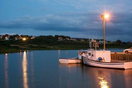 Boats in Inverness harbor, Cape Breton, Nova Scotia Stock Photo