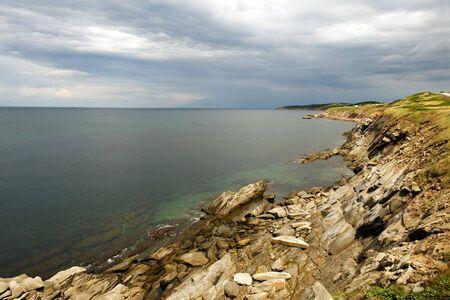 Rocky coast of Cape Breton Highlands, Nova Scotia photo