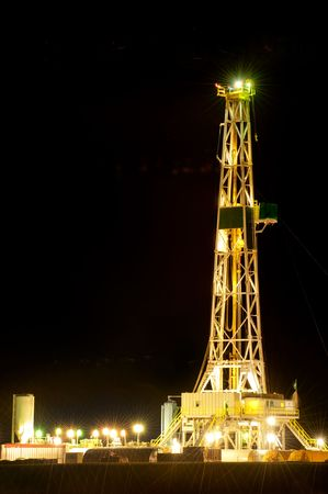 Oil derrick at night on Oklahoma plains Stock Photo