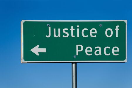 Justice of Peace sign with blue sky background
