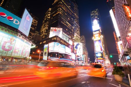 NEW YORK CITY, NY - OCTOBER 20: Taxis in motion on Times Square on October 20, 2010 in Manhattan, New York city 新闻类图片