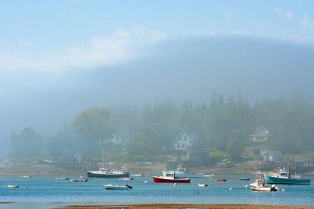 Mist over boats in Bass Harbor, Maine photo