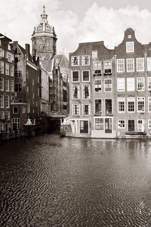 nicolaas: Canal with houses and St. Nicholas Church on background Stock Photo