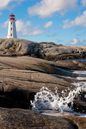 Famous Peggys Point Light in in Peggys Cove, Nova Scotia photo