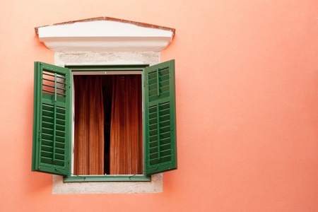 mediterranean houses: Colorful window of the old house in Rab town, Croatia Stock Photo