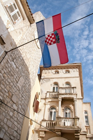 Croatian flag above old part of Rab town photo