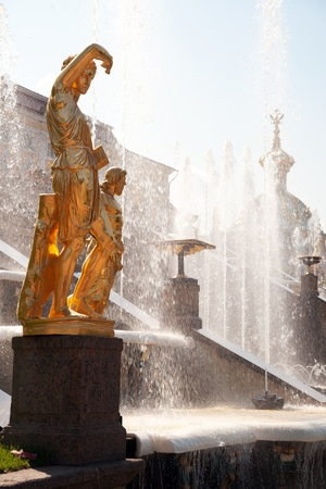 Golden statue of Grand Cascade fountains in Petergof, Russia photo