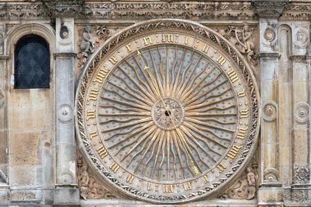 Ancient clock on the facade of famous Chartres cathedral, France Stock Photo