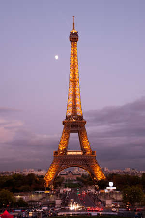 Paris, France, October 10, 2011 - Parisian city life around illuminated Eiffel tower Stock Photo - 11249986