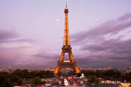 Paris, France, October 10, 2011 - Parisian city life around illuminated Eiffel tower