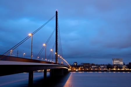 Oberkasseler bridge above Reine river in downtown Dusseldorf, Germany