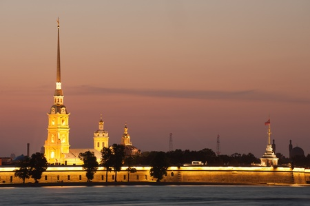 Illuminated Peter and Paul fortress at sunset, St Petersburg photo