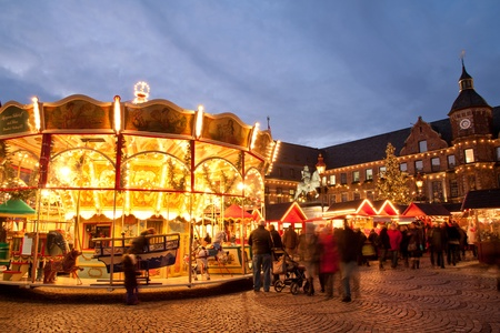 Carousel at Christmas market on Dusseldorf town square