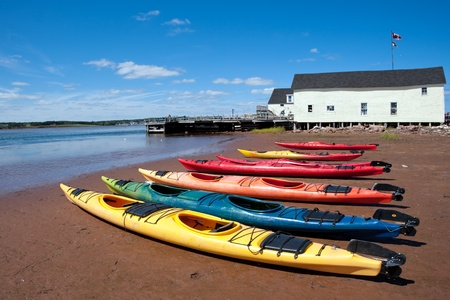 Colorful kayaks on the Prince Edward Island beach photo
